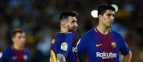 Lionel Messi com seu amigo Suarez