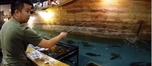 Man fishing for his own dinner at Zauko in Japan [Andrew Vongsa/YouTube screenshot]