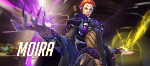 Science will prevail. Moira is introduced. [Image via PlayOverwatch/YouTube screencap]