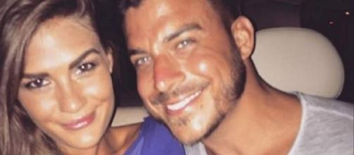 Brittany Cartwright and Jax Taylor pose in a car. [Photo via Instagram]
