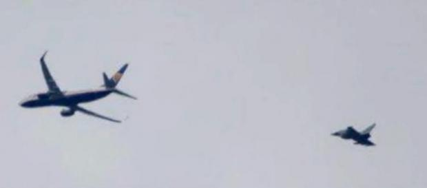 A Ryanair flight was diverted to London Stansted over bomb threat hoax and escorted by RAF fighter jets [Image: YouTube/NEWS UPDATE]