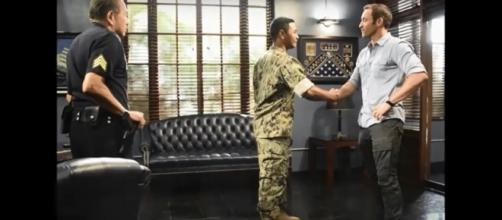 "Alex O'Loughlin greets new cast member, Beulah Koale, on ""Hawaii Five-O"" this week. [Image Credit: Hawaii Five-O/YouTube]"