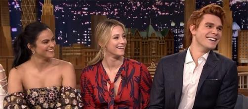 "Camila Mendes, Lili Reinhart, and KJ Apa return this October 13 on ""Riverdale"" 2. (Image Cr: The Tonight Show Starring Jimmy Fallon/YouTube)"