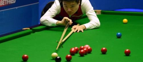 China's Ding Junhui races into world snooker semi-finals – and ... - scmp.com