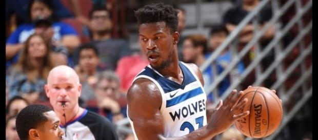 Jimmy Butler and the Timberwolves battle the Golden State Warriors in China as part of the 2017 NBA preseason. [Image via NBA/YouTube]
