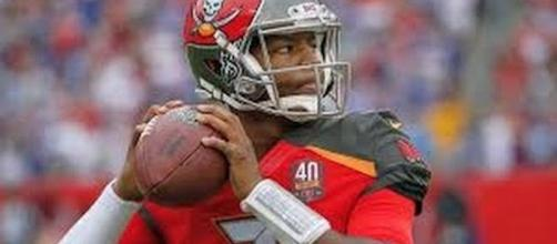 Jameis Winston and the Buccaneers host Tom Brady and the Patriots for Thursday Night Football on CBS and the NFL Network. [Image via NFL/YouTube]