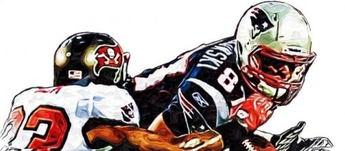 New England Patriots Rob Gronkowski - Tampa Bay Buccaneers Elbert Mack [Image by Jack Kurzenknabe|Flickr| Cropped | Public Domain Mark 1.0 ]