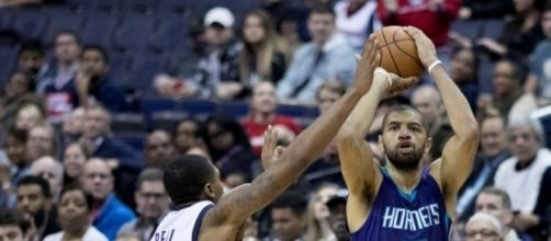 Nicolas Batum averaged 15.1 points, 6.2 boards and 5.9 assists in 77 games last season [Image via Keith Allison/WikiCommons]
