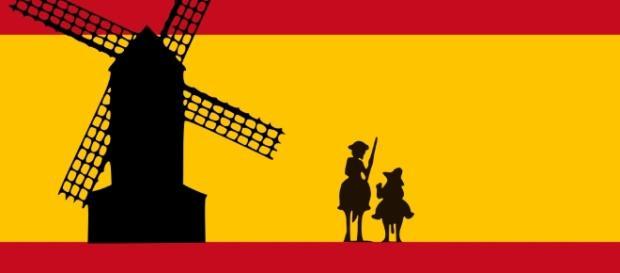 Bandera de España con Don Quijote, Sancho Panza, y Molino de Viento por Oren neu dag/Wikimedia Commons