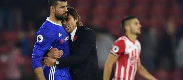 Chelsea manager Antonio Conte hugs Diego Costa in a past match. [Image via Mbah Patrick/Flickr]