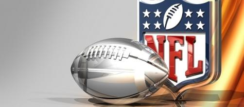 Silver Football and NFL Logo Over Bronze Silk Background [Image by C_osett|Flickr| Cropped | Public Domain Mark 1.0 ]