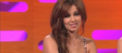 "Cheryl Tweedy, Simon Cowell reunite after 2 years on ""X Factor."" [Image via: BBC/YouTube screenshot]"