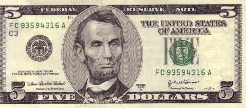 The United States economy is looking up [File:5dollarbill.jpg - Wikimedia Commons - wikimedia.org]