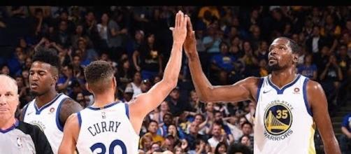 Golden State tries to capture their first win of the NBA preseason on Sunday morning when they face Minnesota. [Image via NBA/YouTube screencap]