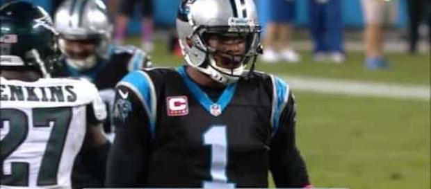 Cam Newton threw three touchdown passes in a 27-24 win over the Detroit Lions Sunday. [Image via NFL/YouTube]