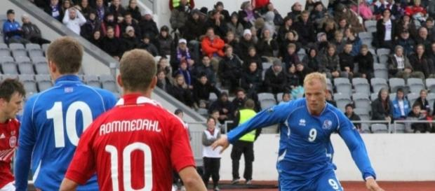 Iceland players (in Blue Shirt) in their past match against Denmark.[Image via Flickr Credit: Helgi Halldorson]