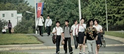 People walking in Pyongyang (Image credit – Matt Paish – Wikimedia Commons)