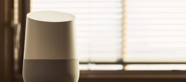 Google Home displayed on a table. (Via Flickr/NDB Photos)
