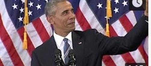 Barack Obama poses for a selfie [Image Source: CNN/YouTube]