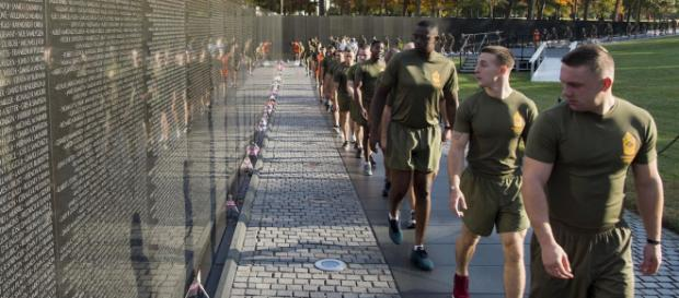 Marines at Vietnam Memorial paying respect. [image source: Defense.gov]
