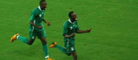 Nigeria soccer players celebrate in a past Olympic competition. (Image Credit: Yang and Yun Album/Flickr)