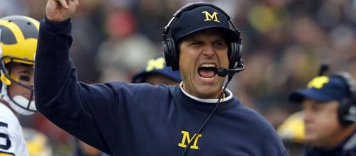 Can the NFL sway Jim Harbaugh away from Michigan? [Image via Wolverine Highlights/YouTube]