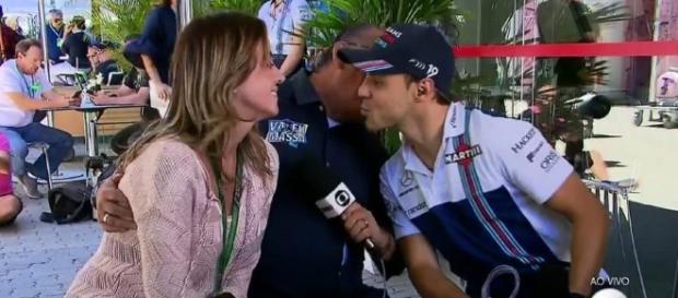 Em uma cena 'inusitada', narrador Galvão Bueno 'invade' beijo de Felipe Massa e esposa