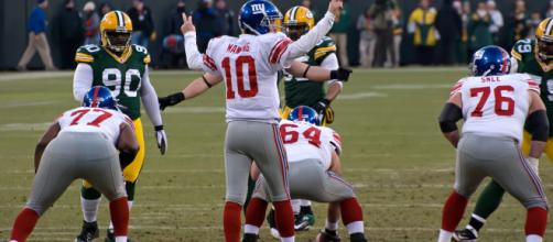 NY Giants QB Eli Manning a team player....[Photo via Mike Morbeck/Flickr]