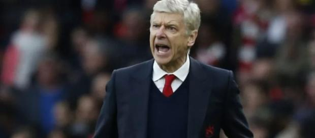 Arsenal manager Arsene Wenger shouts at his players in a past match. (Image Credit: Mbah Patrick/Flickr)