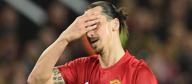 Manchester United striker Zlatan Ibrahimovic covers his face to show his frustration in a past match. (Image Credit: Cs2Kaisar Judi/Flickr)