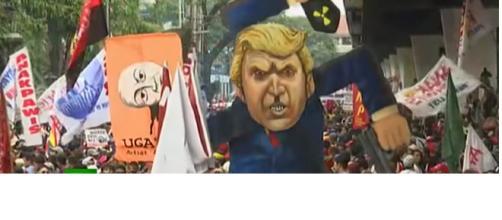 Protesters burn effigy of Donald Trump in Manila. [Photo:RT/YouTube]