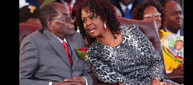 Mugabe and his wife Grace. Photo credit -( screen shot youtube.com)
