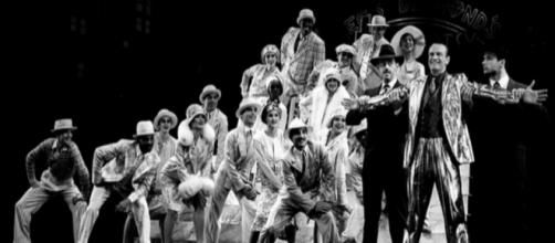 Peter Allen (far right) and the company of the Original 1988-89 Broadway Production of 'Legs Diamond'. (Image via Martha Swope.)