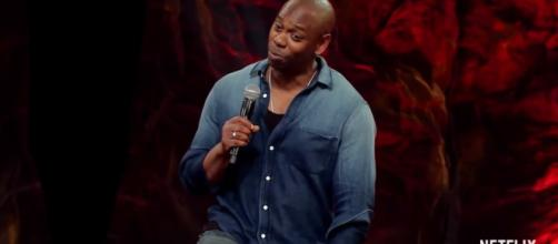 Dave Chappelle is touring around the country and being funny. [ Netflix/Youtube screencaps ]