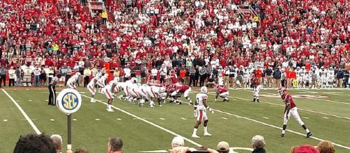 Alabama and Auburn battle in the Iron Bowl (via Wikimedia Commons - Brandon Rush)