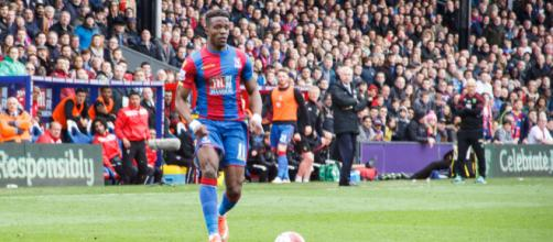 Crystal Palace striker Wilfried Zaha in action in a past match. (Image credit: Gordon Judge/Flickr)
