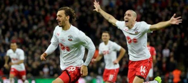 Southampton striker Manolo Gabbiadini (in front) celebrates with Oriol Romeu in a past match. (Image Credit: Indolivescore/Flickr)