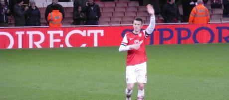 Arsenal defender Laurent Koscielny waves at the fan in a past match. (Image Credit: Wonker/Flickr)