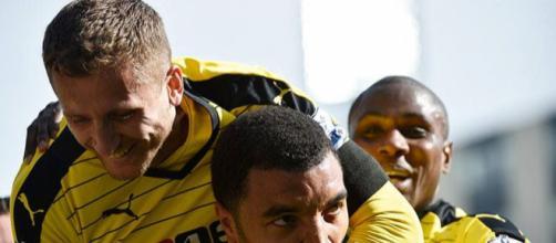 Watford players celebrate Troy Deeney's goal in the past. (Image Credit: MekyCM/Flickr)