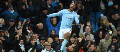 Raheem Sterling celebrates the goal that gave Manchester City the victory when the game was finishing. Photo: Oli Scarff/AFP/Getty Images