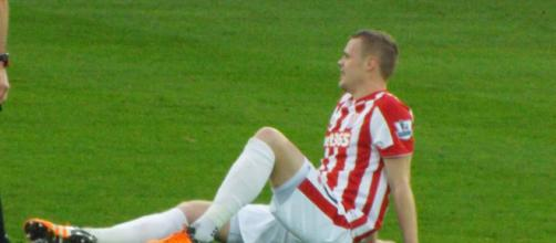 Stoke City captain Ryan Shawcross goes down with an injury in a past match. (Image Credit: Ian Johnson/Flickr)