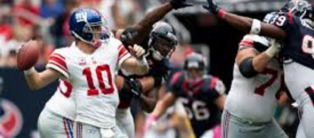 Eli Manning will not be the Giants starting quarterback for the first time in over 13 years this Sunday. - [Image Source: Flickr | AJ Guel]