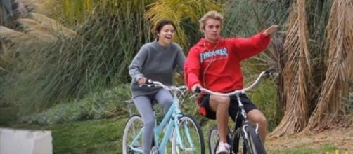 Selena Gomez and Justin Bieber enjoying a bike ride. (Image from RichFiles/YouTube)