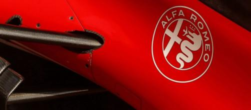 Alfa Romeo car with a logo [Image Credit: Formula 1]