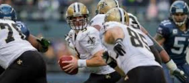 Drew Brees hopes to keep the Saints atop the NFC South against the Panthers. Image Source: Flickr   Kelly Bailey