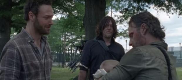 Rick gives baby Gracie to Aaron [Photo via Daryl Dixon, YouTube screencap]