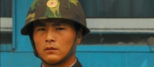 A North Korean Soldier Keeps Face (Image via: Wikimedia Commons).
