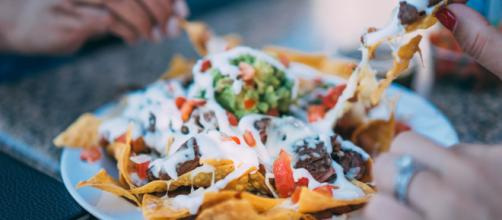 National Nachos Day celebrates one of the most popular dishes ever invented. [Image by Stocksnap at Pixabay]