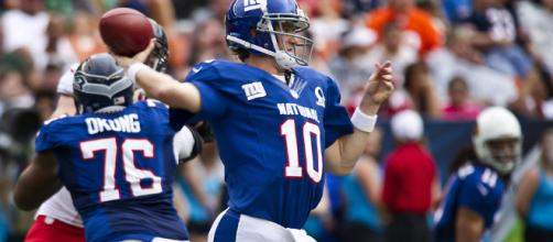Eli Manning of the New York Giants [Image by Tech. Sgt. Michael Holzworth / Wikimedia Commons]