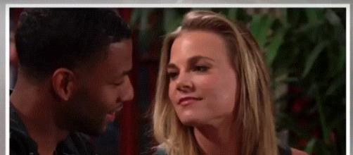 Phyllis distracts Jordan while Hilary snoops. (Image via The Young and the Restless worldwide youtube screencap).